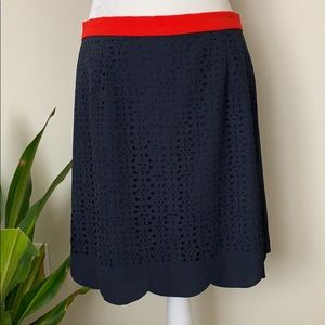 Pixley navy skirt with laser cut detail on front.
